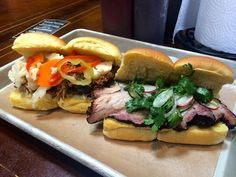 Pulled Pork with roasted garlic aioli and giardiniera and Pork Belly with red onion, radish, cilantro and lemon sandwiches