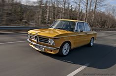 Goldenrod BMW 2002 with chrome detailing