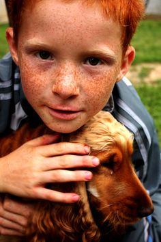 Ginger boy with ginger dog.