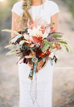 Like: Varied plants, using a unique ribbon. But I think I would prefer lace. Don't like: too big, too wild. Definitely don't want native american indian art.