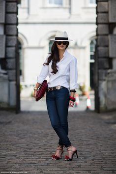 Peony Lim in white shirt and blue jeans, Hermés belt and burgundy bag. The punk luxury sandals make look the outfit informal.