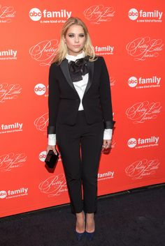 With a ruffled neckline and floppy black bow, there was nothing subtle about the suiting look Ashley Benson picked for the finale screening of Pretty Little Liars. Her tuxedo jacket, by Max Mara, could be worn solo or over a cocktail dress, but we love it with dark pants, a white blouse, and a mini Edie Parker clutch.