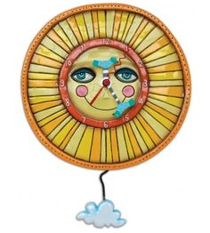 Sunny Skies Sun Clock. Want some light in your life? What would be better than a wall clock with rays of sunshine?! With little blue birds as the clock hands and a swinging cloud as the pendulum, this wall clock is sure to bring some cheer to any room. Comes with AA battery.