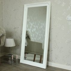 Extra Large White Ornate Wall/Floor Mirror A stunning full length mirror in white with an antique finish Fabulous huge size, perfect for floor standing or wall mounting or a great idea for a dressing room With ornate style detailing Also available in silver and cream www.melodymaison.co.uk