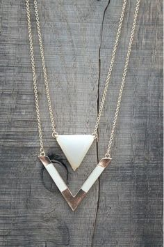 Boho Chic! Check out this new gold Triangle Double Layer Necklace! Available now at http://www.herringstonesboutique.com!