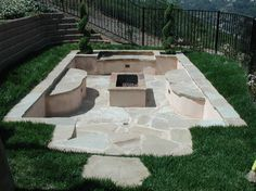Old pool turned into a firepit patio