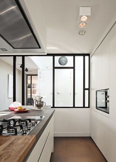 Amsterdam canal house kitchen with custom kitchen by Scalo with no handles