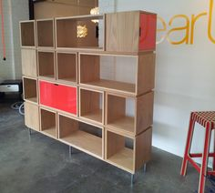 shelving unit with gloss red laminate doors by alex earl, aus.