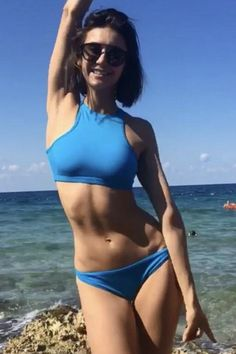 Nina Dobrev wearing Westward Leaning Flower 28 Sunglasses and La Perla Waves Ruffle Bikini Briefs in Teal