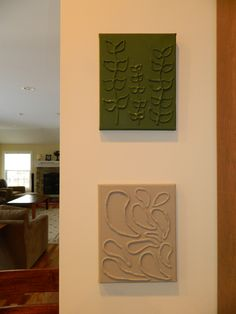 I made these two canvas art pieces today for my kitchen.  I used a blank canvas, glue gun and acrylic paint!