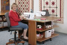 Eleanor Burns studio- counter height work stations with adjustable chairs for sewing at that ht.  Nice ledge for feet and pedal.