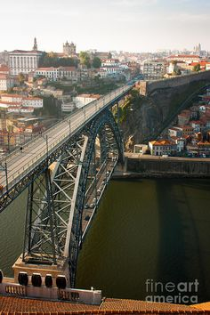 O Porto Eiffel Bridge Portugal  > upper level was used to transport cable cars, back in the day. I far as I can find so far, was built by Eiffel in around 1887. will let you know if I come across any other history...
