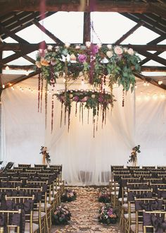 Beautiful floral chandeliers, ribbon ceremony chairs and floral aisle ~ we ❤ this! moncheribridals.com