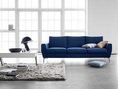 The Monaco sofa, shown here in dark blue Frisco fabric, can be customised to fit the size of your home.