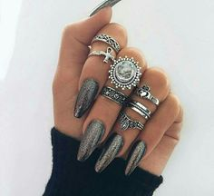 Beautiful shining silver nails with rings