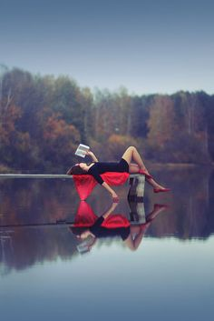 reading a book on a lake