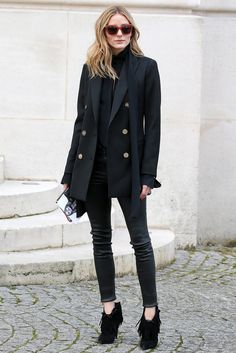 The style pro added fringed heels to a blazer and leather pants for a wow factor outside the Balmain show.