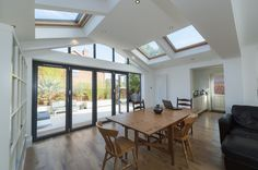 Discover Solid Roof Orangeries from Eden and see why homeowners throughout Kent & South East London choose a modern and stylish Solid Tiled Roof Orangery. Conservatory Extension, Roof Extension, Extension Ideas, Warm Roof, Modern Patio Doors, Modern Conservatory, Cottage Renovation, House Extensions, New Homes