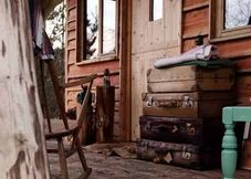 Love these old suitcases on the veranda of a lovely cabin