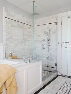 master bathroom glass shower w stone tile keep it light to make room look larger wood front for tub