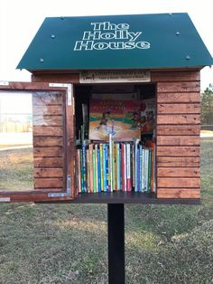 This beautiful Holly House LFL was built by a local city councilman using scraps of wood from his campaign signs! It is truly beautiful and is always packed full of books!