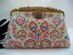 Completely made by hand, in France, during the 1930 - 1940 era, this purse is the epitome of French beaded elegance and chic high fashion.