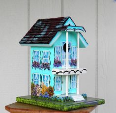 Handcrafted Birdhouse with a New Orleans Style and a lot of Flowers.  via Etsy.