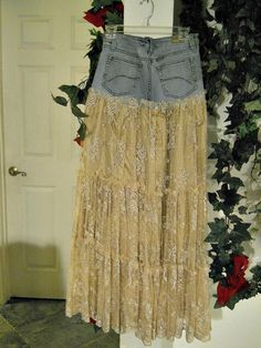 This Belle Bohémienne jean skirt is one of my line of Renaissance Denim Couture, the name I chose for my line of couture because I take vintage denim and give it new life with French bohemian flair.  (This listing is for a made to order jean skirt as pictured, but in your size and desired length.)  To make this Renaissance Denim couture, I took a pair of size 5 vintage jeans and formed a yoke at the top.  Then, I took LOTS of gorgeous, shimmery beige lace and made ruffled layers with an…