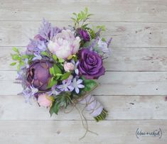 Wildflower bouquet in shades of purple and lavender. This boho bouquet is filled with lavender, light purple, and dark purple/plum flowers. The silk flowers are mixed together with faux greenery and statice to create a romantic wedding bouquet with a ton of texture. This bouquet