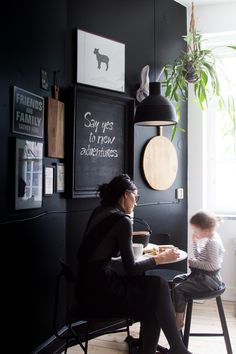 Fika time with Genevieve and Olivia in a lovely Swedish kitchen with black accent wall