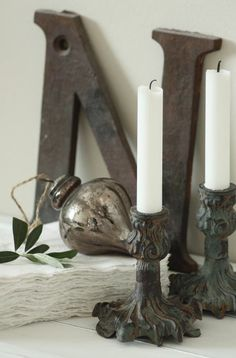 """vintage cast iron candlestick holders...mercury glass ornament... and the letter """"N'"""