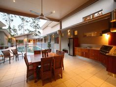 pool + outdoor kitchen & dining