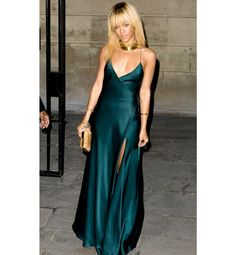 ELLE May Cover Shoot: Rihanna :Wearing a plunging custom forest green Giorgio Armani gown and Tom Ford python heels