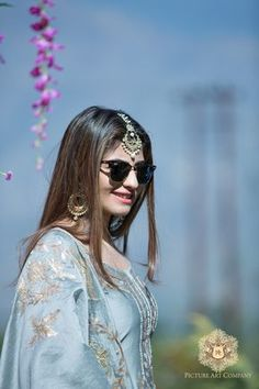 Looking for Bride in Mehendi Function Wearing Sunglasses? Browse of latest bridal photos, lehenga & jewelry designs, decor ideas, etc. on WedMeGood Gallery. Indian Suits, Indian Attire, Indian Wear, Designer Punjabi Suits, Indian Designer Wear, Pakistani Dresses, Indian Dresses, Shadi Dresses, Pakistani Bridal