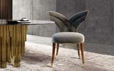 Luna Dining Chair - An unusual majestic elegance surrounds the Luna dining chair. The slender and curved solid walnut legs with brass accents join the surprising and memorable wing-shaped backrest. The extreme comfort of the chair, although absorbing, leaves center stage to the seductive feminine lines of Luna.