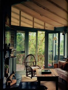 dyingofcute: Indoor porch with rustic decor and a little book shelving. I love this indoor porch.I would put a hot tub and skylights in of course.