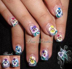 Sculpted gel enhancement with hand painted floral design.  #onestrokepainting  #floralnaildesign #floralnailart #roses #floral #handpaintedflowers #pinkandwhites #frenchnails #gelnails #nailart #handpaintednails #naildesign #nails #lisakorallus #liquidglamour #nailpictures #pansies
