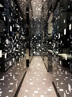 Ocean of Dots  Tetsuya Matsumoto's Toshin Eisei Yobiko Okayama office interior design feels like an art installation with floating dots surrounding the visitors.