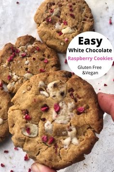 Super easy 6 ingredient white chocolate raspberry cookies. These are crispy on the outside and soft in the middle, just the way a cookie should be. Using freeze dried raspberry means you can make these all-year round. The dairy free white chocolate and gluten free flour makes these cookies vegan as well as gluten free. So, everyone can get stuck in and enjoy a cookie.