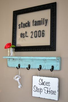 when i first read this i thought it said SOCK family...so i got the idea to do this in my laundry room! with clothes pins to hold the missing socks and have the EST yr to be the yr we first had kids LOL!!