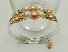 Beaded, Customizable, Peach/Tan Swarovski Crystal and Glass Pearl Memory Wire… - Beaded, Customizable, Peach/Tan Swarovski Crystal and Glass Pearl Memory Wire… - Beaded, Customizable, Peach/Tan Swarovski Crystal and Glass Pearl Memory Wire… - Beaded, Customizable, Peach/Tan Swarovski Crystal and Glass Pearl Memory Wire Bracelet via Etsy