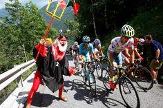 2016 10/7 rit 9 > Rafal Majka, wearing the polka dot jersey, isn't distracted by another staple of Le Tour: El Diablo aka Didi Senft [photo Kim Ludbrook/EPA/The Boston Globe]