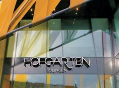 Hofgarten Solingen Germany - RSM Design Environmental Design Architectural Experiential Branded Placemaking Public Art Exterior Wall Graphics Installation Facade Design Entrance Shopping Mall Green Wall Identity Sign