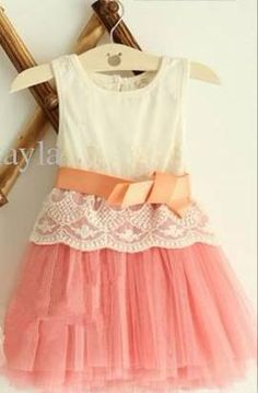 What an adorable idea for a girls dress!  Tulle skirt with a lace top. <3