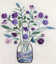 Lazy daisy + a French knot for the flowers. Closed fly stitch for the leaves.  Stem stitch for the stems. Embroidery.