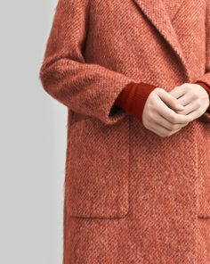 A classic fitted double breasted coat in a luxurious soft hairy wool. Strap inside to button up the left side. Classic just under knee length, ideal for wrapping yourself up for fall. <br> <br> - Textured, soft mohair <br> - Under knee length <br> -