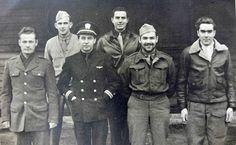 """POWs at Stalag Luft III Capt. Louis R. McKesson, 306BG; 1st Lt. Robert Ray Brunn, 91BG (back row, left to right) 2Lt Thomas E. """"Eddie"""" Mulligan, 303BG/359BS; Lt(sg) John Dunn, first American POW in Stalag Luft III; Maj. Edward Wheeler; Lt(jg) John H. Palmer, VT-4 (front row, left to right) Photo taken February 10, 1944"""