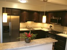 kitchen dark cabinets light granite, white trim | ideas for new