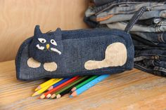 Denim pencil case , recycled upcycled denim storage , pencil pouch , shoe , denim travel bag , pen case , denim zipper pouch , upcycled shoe by SecondBirthday on Etsy https://www.etsy.com/listing/492253127/denim-pencil-case-recycled-upcycled