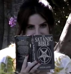 Lana del Rey reading the Satanic bible